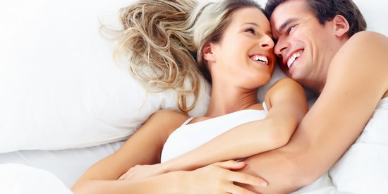 ONE HEART- NOT TWO - COUPLE SMILING IN BED