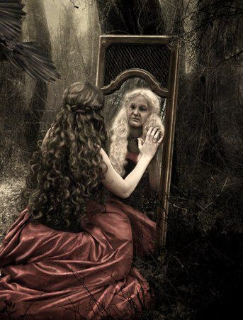 YOUNG GIRL LOOKS IN MIRROR AND SEES OLDER SELF