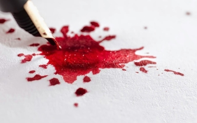 A PEN WITH BLOOD FOR INK