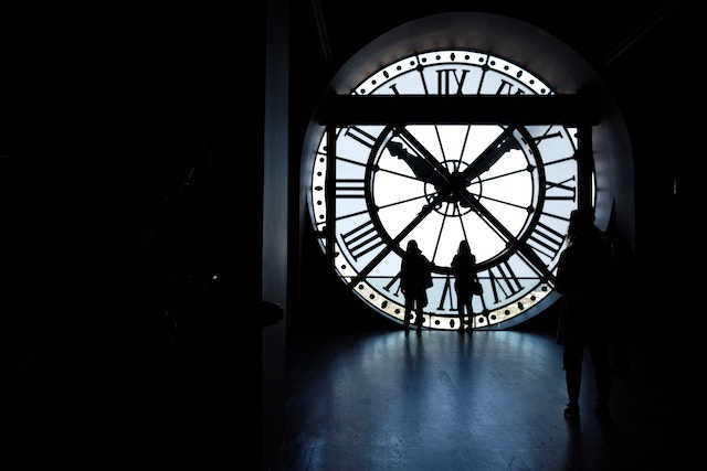 three line tales, week 165: people in front of a giant clock face