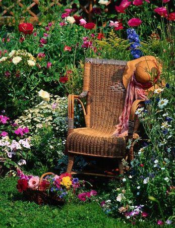 305799-Antique-Wicker-Rocking-Chair-In-A-Flower-Garden